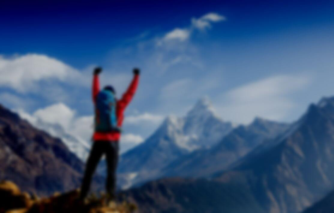 Mountain climber celebrating reaching the summit